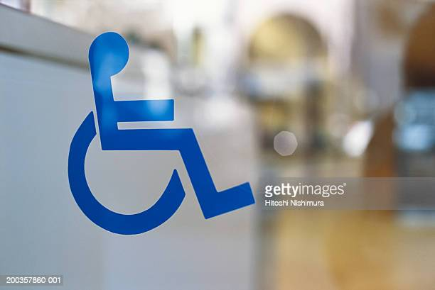 wheelchair symbol - disabled sign stock photos and pictures