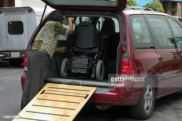 wheelchair transport - disabled access stock photos and pictures