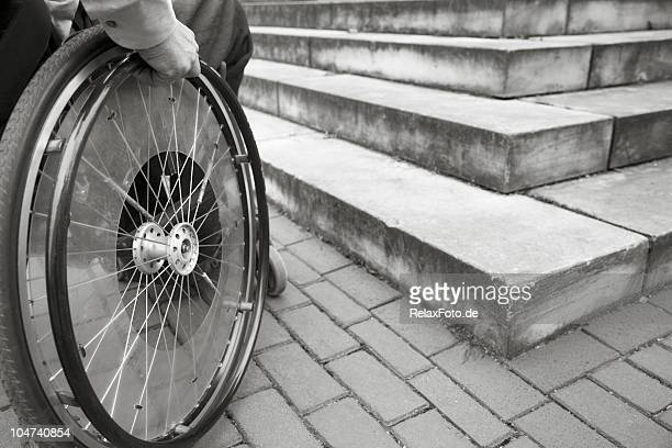 wheelchair user in front of staircase barrier (xxl) - prejudice stock photos and pictures