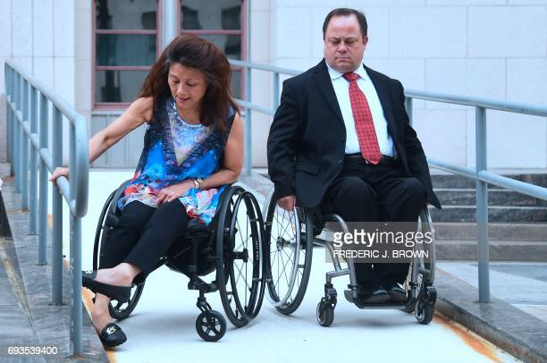 Wheelchair user Mei Ling is followed by her attorney Scott Moore to a media briefing outside the US Court House in downtown Los Angeles California on...