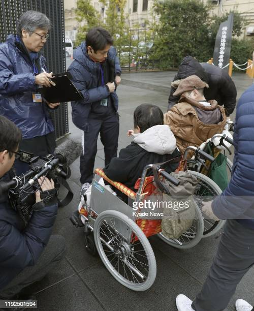 Wheelchair users are among those taking part in a ticket draw in Yokohama on Jan 8 for the first trial hearing of Satoshi Uematsu accused of killing...
