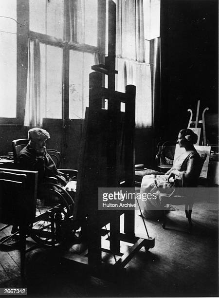 Wheelchairbound artist Auguste Renoir painting in his studio at Les Collettes Cagnes France