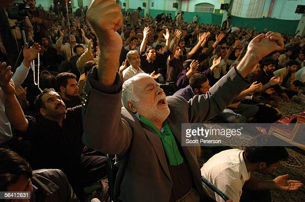 Wheelchairbound devotee prays for healing at the Jamkaran Mosque December 6 2005 in Jamkaran Iran Some Iranian Shiites believe and are waiting for...