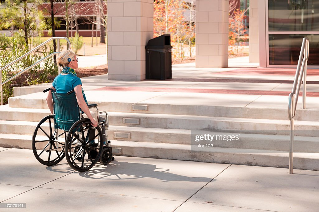 Wheelchair-bound woman faces inaccessible stairs. Civil rights. : Stock Photo
