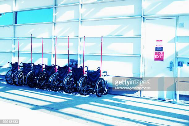 Wheelchairs in a row in an airport