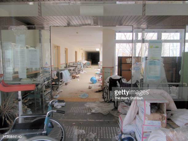 Wheelchairs, plastic bottles, towels, buckets and paper plates remain scattered on the corridor of Futaba Hospital, where is inside the exclusion...