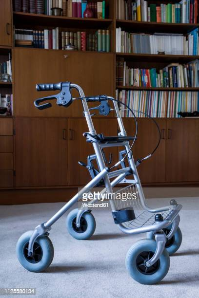 Wheeled wlaker in front of a book shelf