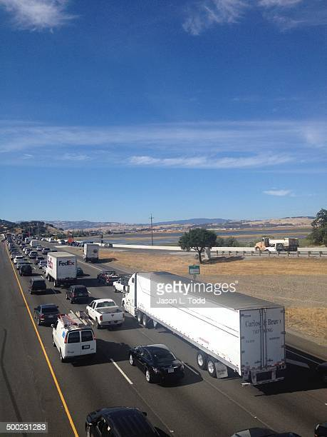 18 wheeler semi truck and vehicles in traffic jam along highway 101 freeway in Novato Northern California heading north towards Petaluma and Santa...