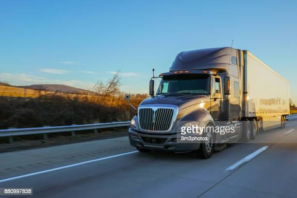 18 wheeler semi truck on road at sunrise - autonomous technology stock pictures, royalty-free photos & images