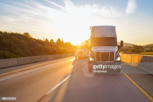 18 wheeler truck on road at sunrise