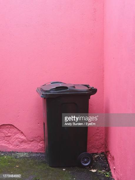 wheelie style refuse bin against a pink wall - malton stock pictures, royalty-free photos & images