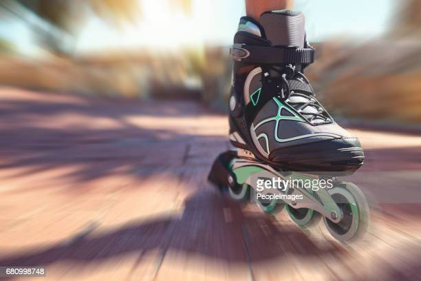 wheeling down the promenade - inline skate stock photos and pictures
