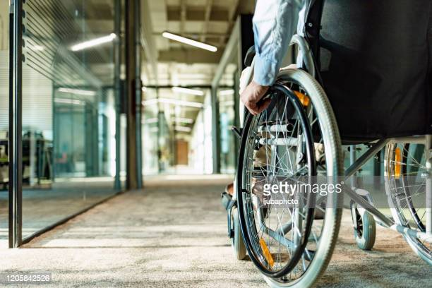 wheeling his way into recovery - equality stock pictures, royalty-free photos & images