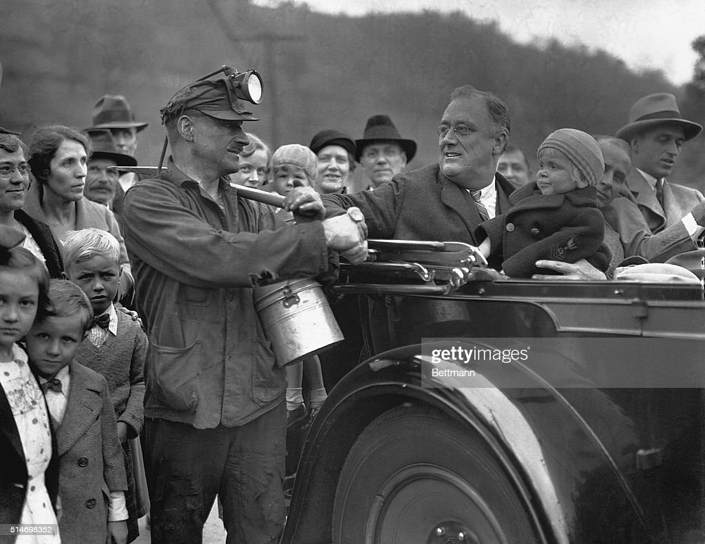 Franklin Delano Roosevelt Shakes Hands with Miner : News Photo
