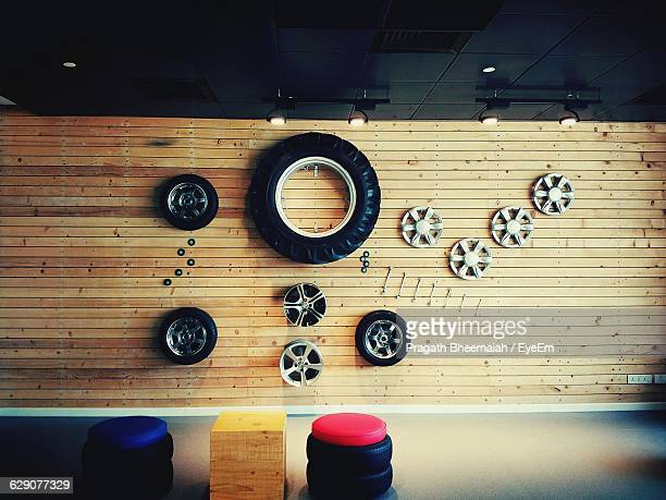 Wheels And Rims Mounted On Wood At Garage