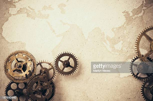 wheels are turning in the global market - steampunk stock pictures, royalty-free photos & images