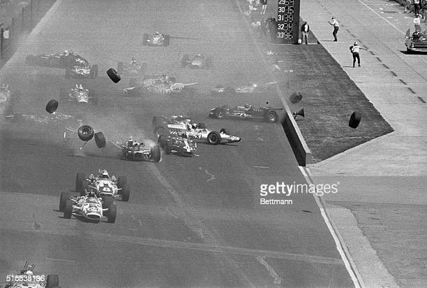Wheels fly as racing cars collide in a spectacular pileup at the start of the 1966 500 mile Memorial Day Race at the Indianapolis Indiana Speedway...
