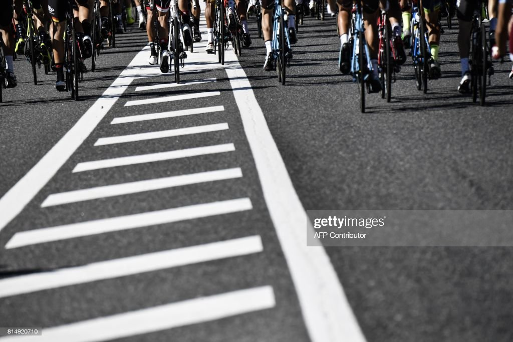 Wheels of cyclists riding are pictured during the 181,5 km fourteenth stage of the 104th edition of the Tour de France cycling race on July 15, 2017 between Blagnac and Rodez. / AFP PHOTO / Jeff PACHOUD