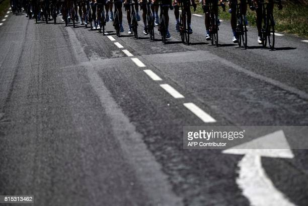 Wheels of cyclists riding are pictured during the 181,5 km fourteenth stage of the 104th edition of the Tour de France cycling race on July 15, 2017...