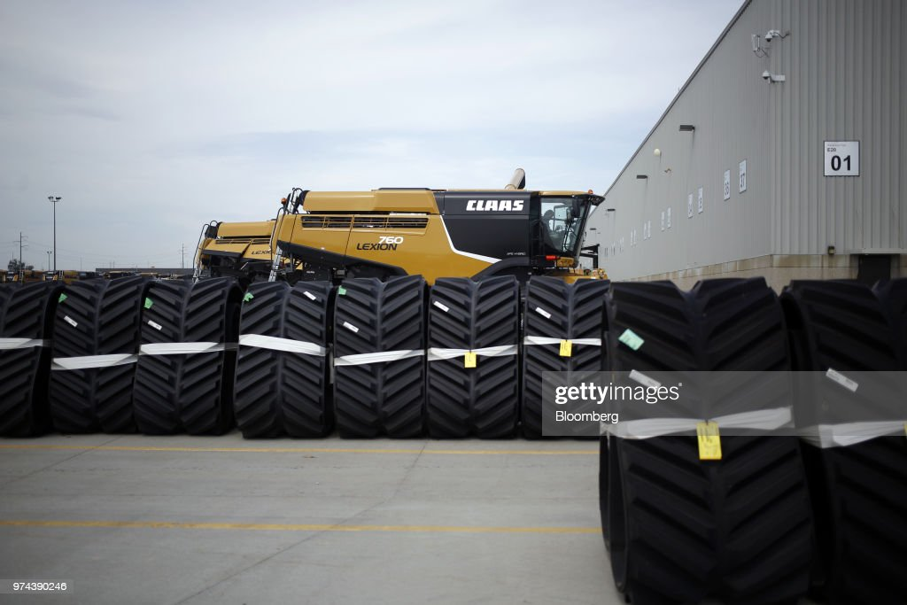 Wheels sit in front of a combine harvester outside the CLAAS of America Inc. production facility in Omaha, Nebraska, U.S., on Wednesday, June 6, 2018. The Federal Reserve is scheduled to release industrial production figures on June 15. Photographer: Luke Sharrett/Bloomberg via Getty Images