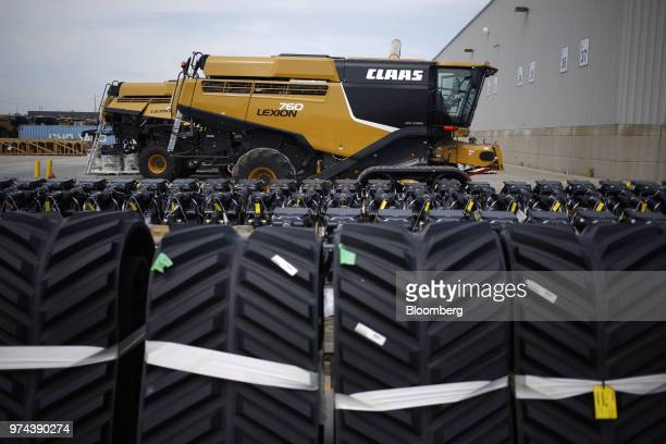 Wheels sit in front of a combine harvester outside the CLAAS of America Inc production facility in Omaha Nebraska US on Wednesday June 6 2018 The...