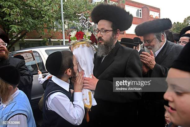 When a new Sefer Torah is completed after years of work it is carried in a big community parade to synagogue. Rabbis and leaders young and old from...