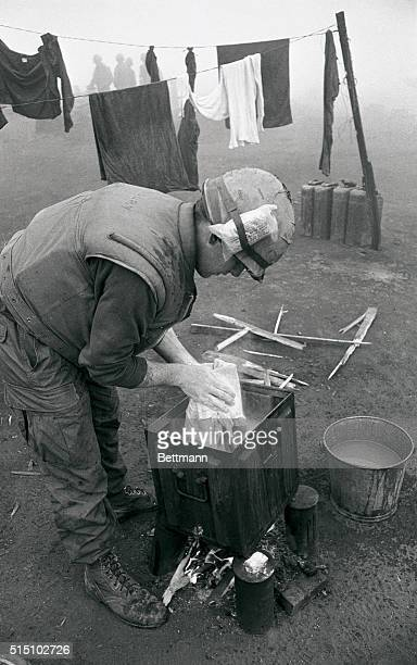 When dense fog prevented the North Vietnamese from shelling this fortress the US Marines got a chance to catch up on some chores As seen here L/Cpl...