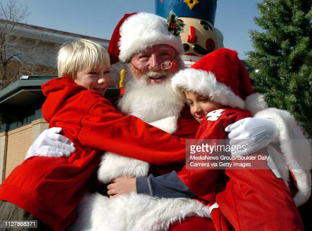 When do you tell your kids about Santa Claus or do you let them find out on their ownQuinn Conroy left and brother Casey give Santa Claus a hug after...