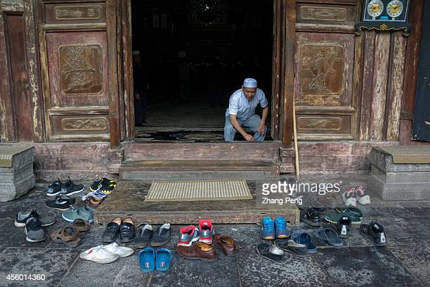 XI'AN SHAANXI CHINA When Muslims make worship in the hall of the Xi'an Great Mosque they take off their shoes outside The hall can hold 1000...