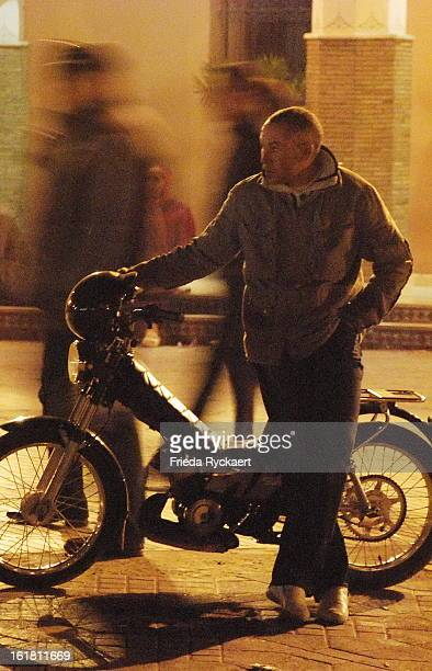 CONTENT] When night fallsyoung man with motorbike at the Djemaa el Fna square in Marrakech The central square of the city where once executions took...