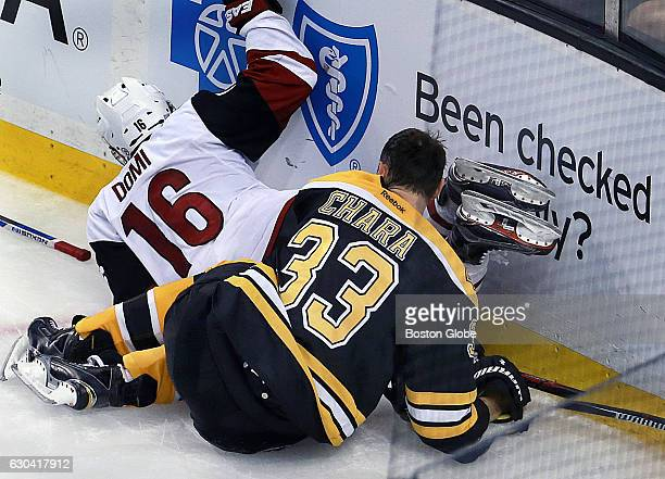 When the Bruins' Zdeno Chara and the Coyotes' Max Domi go into the boards together in the third period the Boston captain loses his helmet and is...