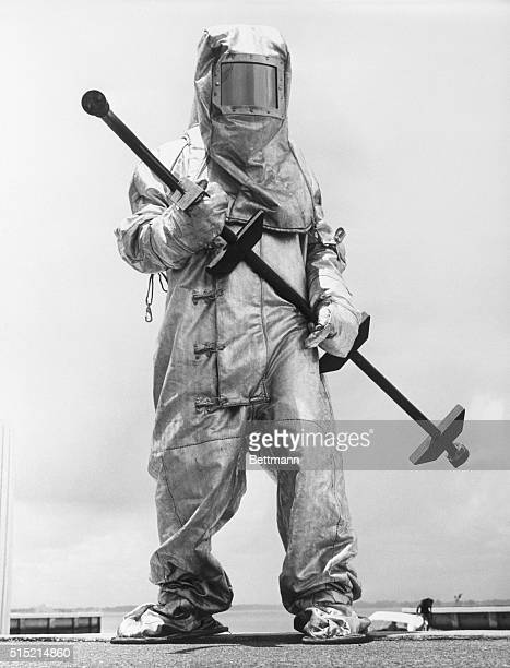 8/26/1961 When the need arises the waterborne fireman can don this asbestos suit and board the boat to fight the blaze at close range His...