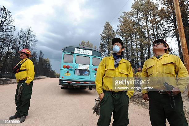 When thunderstorms threatened the Black Forest area a group of firefighters from Ramah New Mexico take a break from knocking down hot spots in...