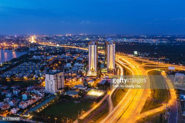 when viewed from cantavil, district 2, in which the new urban area of thu thiem is located, is an urban district of ho chi minh city, vietnam - thiem foto e immagini stock