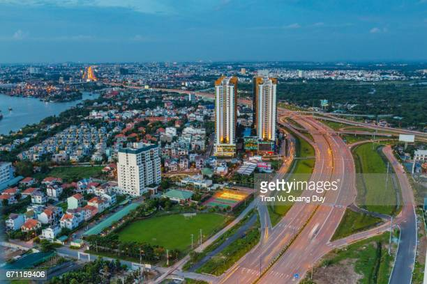 when viewed from cantavil, district 2, in which the new urban area of thu thiem is located, is an urban district of ho chi minh city, vietnam - thiem stock-fotos und bilder