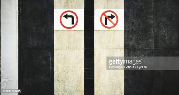 where are you going new or same - crossing sign stock pictures, royalty-free photos & images