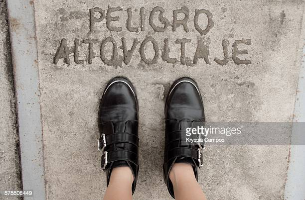 pov: where are your feet? - leather boot stock pictures, royalty-free photos & images