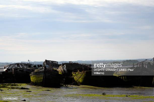 where boats are laid to rest (boat graveyard at hoo marina) - marina stock pictures, royalty-free photos & images