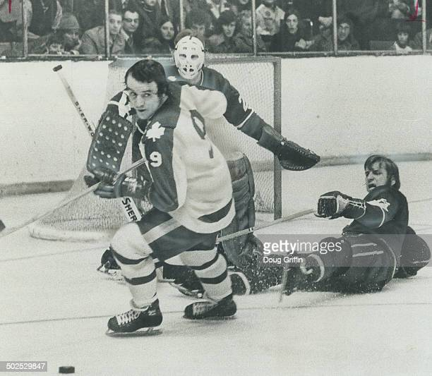 Where did it go Maple Leafs' Norm Ullman can't seem to see puck as he wheels away from Vancouver Canuck's goal guarded by rookie netminder Ed Dyck...