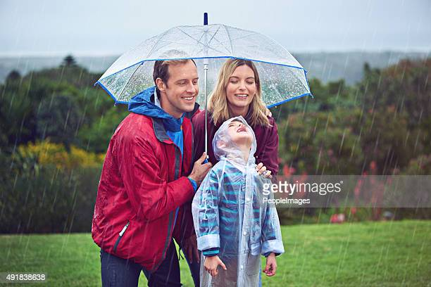 where does the rain come from? - mother son shower stock photos and pictures