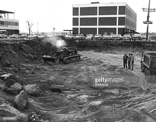 JAN 26 1960 Where GanoDowns will Build its first branch Power shovel sits in the excavation it is completing at E 2nd Ave and Fillmore St for a...