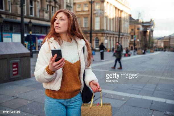 where is that shop? - holding stock pictures, royalty-free photos & images