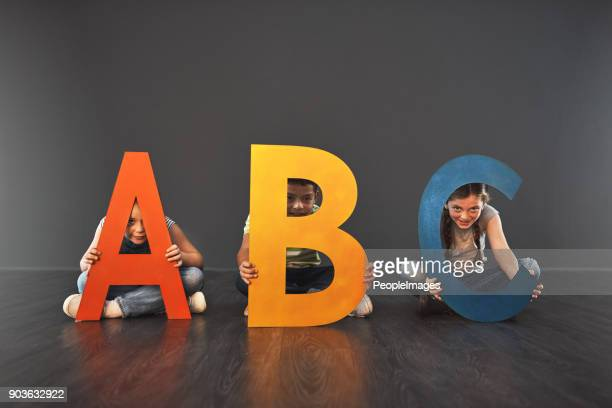 where literacy starts - alphabet stock pictures, royalty-free photos & images