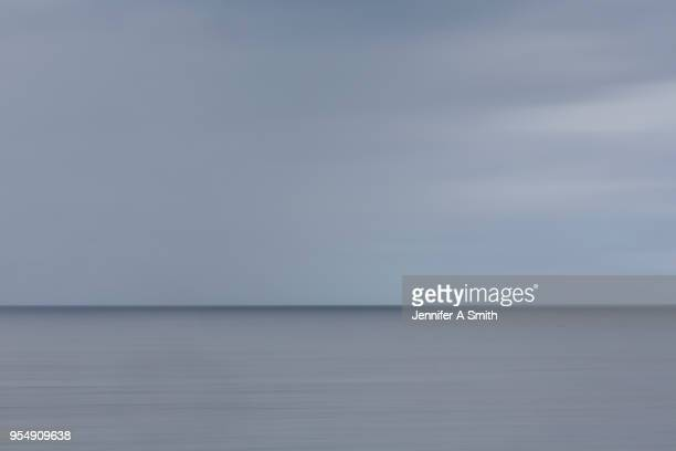where sky meets ocean. - overcast stock pictures, royalty-free photos & images