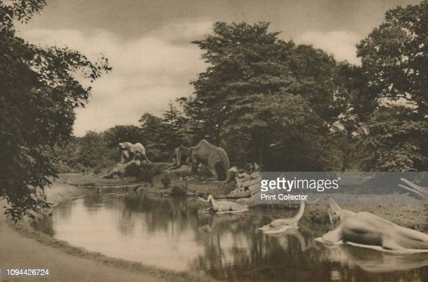 Where the Beasts of Prehistory Lurk By the Lake in the Palace Grounds' circa 1935 Statues of lifesize prehistoric monsters dating from 1854 in...