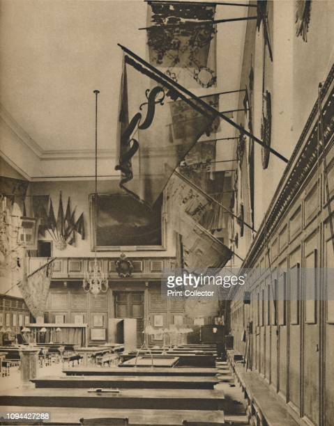 Where the Pensioners Dine Under Colours Gloriously Tattered', circa 1935. Great Hall of the Royal Hospital Chelsea, south-west London, which was...