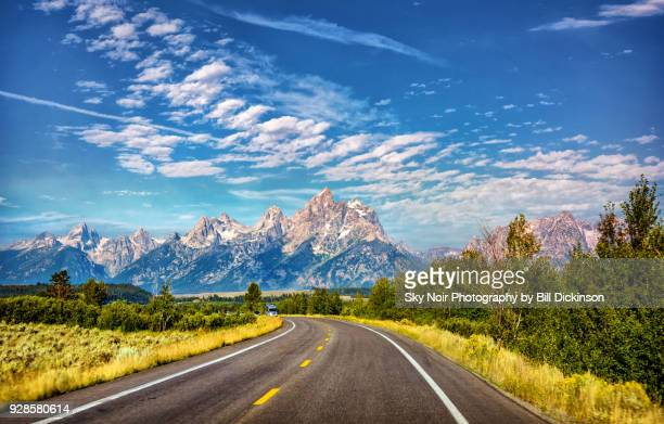 where the road leads - mountain range stock pictures, royalty-free photos & images