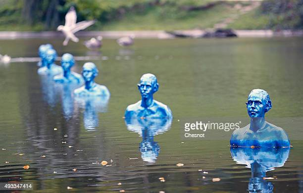 'Where the Tides Ebb and Flow' installation of 35 blue clone sculptures by Argentine artist Pedro Marzorati at the Park Montsouris on October 19 2015...
