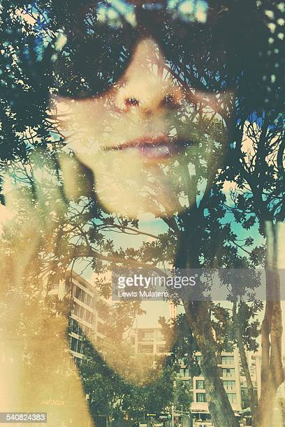 Where the trees still grow Self portrait double exposure Female face with double exposure trees and apartments in the city