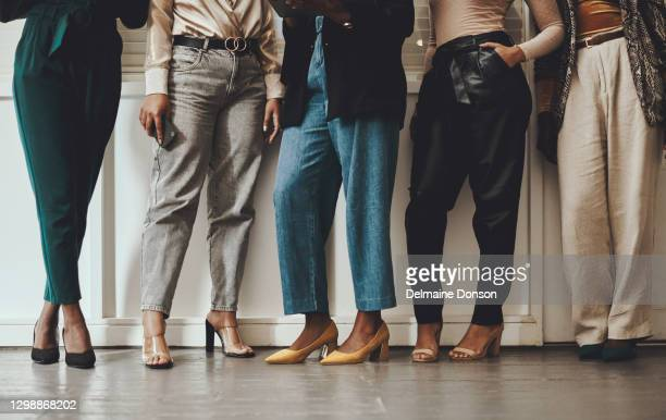 where there's solidarity, there's strength - black trousers stock pictures, royalty-free photos & images